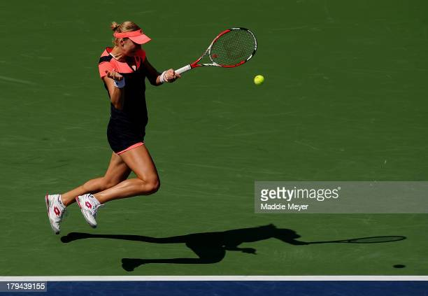 Ekaterina Makarova of Russia plays a forehand during her women's singles quarterfinal match against Na Li of China on Day Nine of the 2013 US Open at...