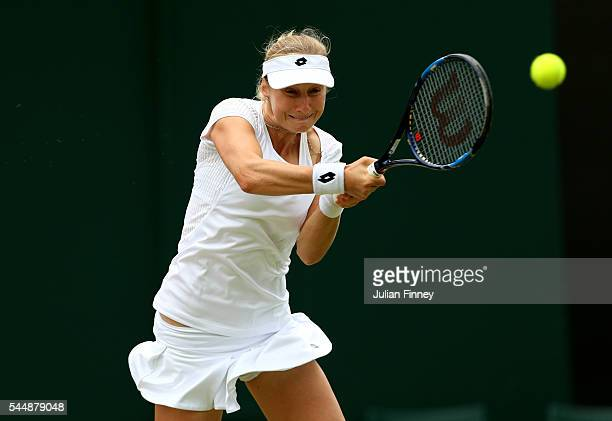 Ekaterina Makarova of Russia plays a forehand during the Ladies Singles fourth round match against Elena Vesnina of Russia on day seven of the...