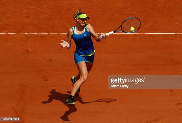 Ekaterina Makarova of Russia plays a forehand during the ladies singles first round match against Angelique Kerber of Germany on day one of the 2017...