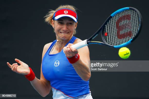 Ekaterina Makarova of Russia plays a forehand in her first round match against IrinaCamelia Begu of Romania on day one of the 2018 Australian Open at...