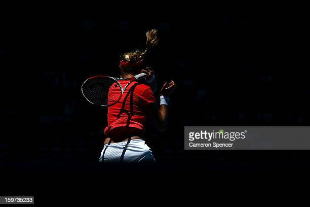 Ekaterina Makarova of Russia plays a forehand in her fourth round match against Angelique Kerber of Germany during day seven of the 2013 Australian...