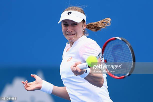 Ekaterina Makarova of Russia plays a forehand in her match against Carla Suarez Navarro of Spain during day three of the 2014 Sydney International at...
