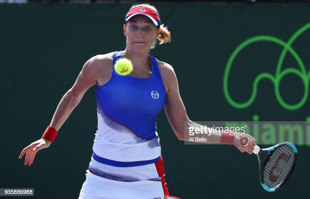 Ekaterina Makarova of Russia plays a shot against Timea Bacsinszky Switzerland during Day 3 of the Miami Open at the Crandon Park Tennis Center on...