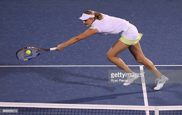 Ekaterina Makarova of Russia plays a volley during her first round match against Marion Bartoli of France during day one of the WTA Barclays Dubai...