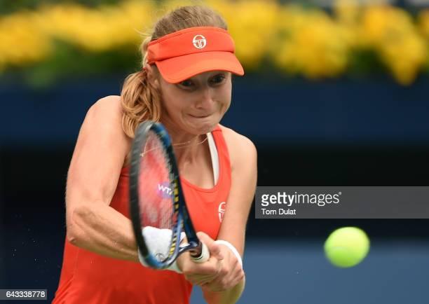 Ekaterina Makarova of Russia plays backhand against Dominika Cibulkova of Slovakia on day three of the WTA Dubai Duty Free Tennis Championship at the...