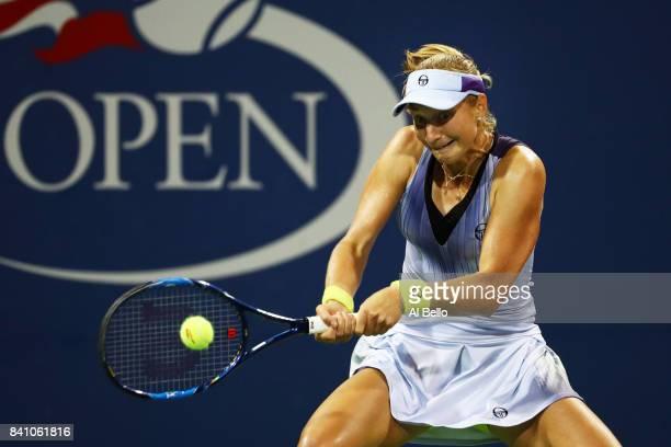 Ekaterina Makarova of Russia returns a shot against Caroline Wozniacki of Denmark during their second round Women's Singles match on Day Three of the...