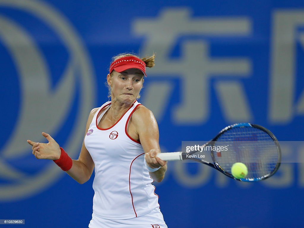 Ekaterina Makarova of Russia returns a shot against Sabine Lisicki of Germany in a match during Day 1 of the 2016 Wuhan Open at Optics Valley International Tennis Center on September 25, 2016 in Wuhan, China.