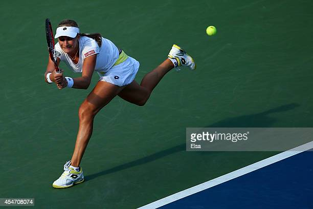 Ekaterina Makarova of Russia returns a shot against Serena Williams of the United States during their women's singles semifinal match on Day Twelve...