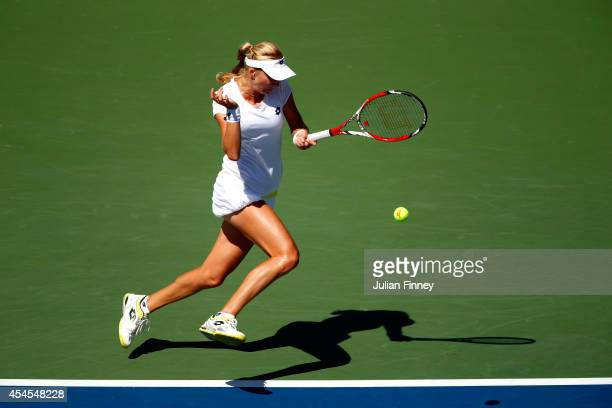 Ekaterina Makarova of Russia returns a shot against Victoria Azarenka of Belarus during threir women's singles quarterfinal match on Day Ten of the...