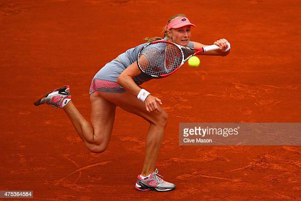 Ekaterina Makarova of Russia returns a shot in her Women's Singles match against Ana Ivanovic of Serbia on day eight of the 2015 French Open at...