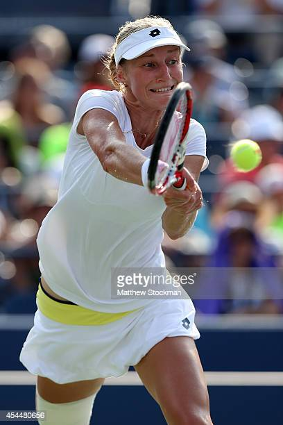 Ekaterina Makarova of Russia returns a shot to Eugenie Bouchard of Canada during their womens singles fourth round match on Day Eight of the 2014 US...
