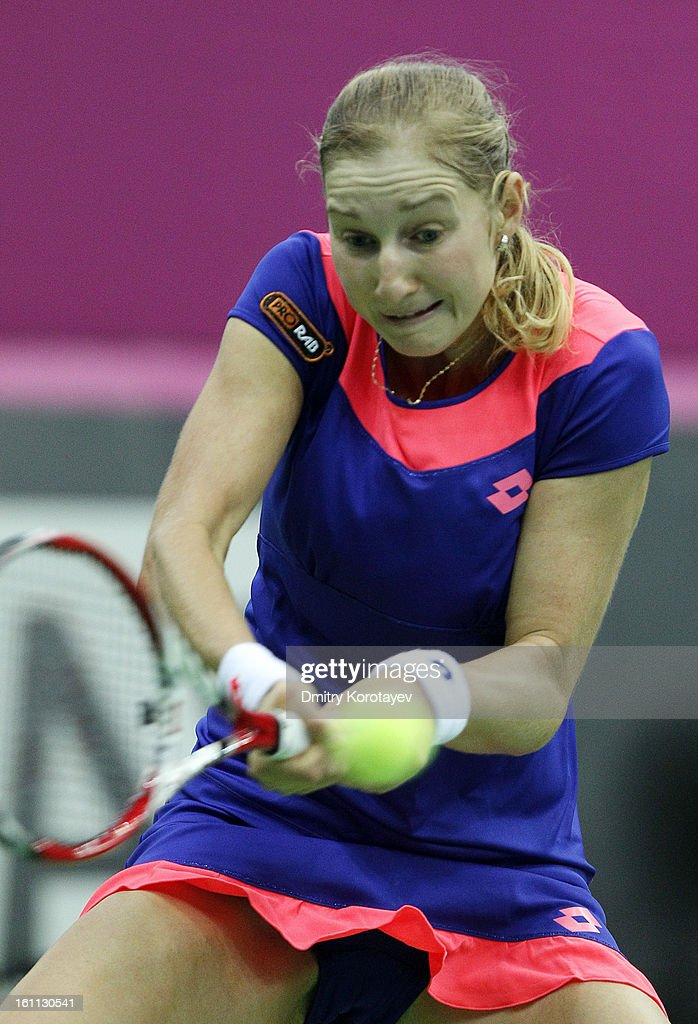 Ekaterina Makarova of Russia returns the ball against Ayumi Morita of Japan during day one of the Federation Cup 2013 World Group Quarterfinal match between Russia and Japan at Olympic Stadium on February 09, 2013 in Moscow, Russia.