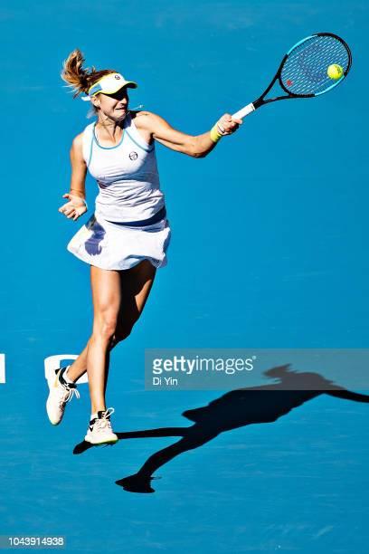 Ekaterina Makarova of Russia returns the ball against Garbine Muguruza of Spain during her women's singles first round match of the 2018 China Open...