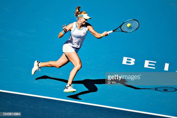 Ekaterina Makarova of Russia returns the ball against Garbine Muguruza of Spain during her women's singles first round match of the 2018 China Open...