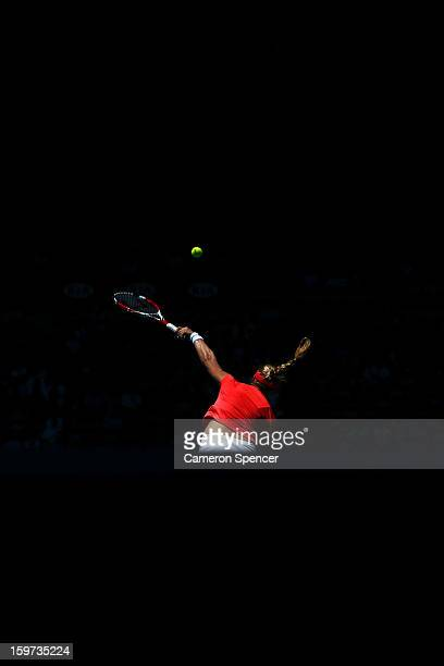Ekaterina Makarova of Russia serves in her fourth round match against Angelique Kerber of Germany during day seven of the 2013 Australian Open at...