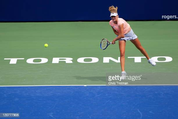 Ekaterina Makarova of Russia serves to Francesca Schiavone of Italy on Day 3 of the Rogers Cup presented by National Bank at the Rexall Centre on...