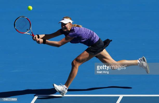 Ekaterina Makarova of Russia stretches out to play a backhand in her first round match against Varvara Lepchenko of USA during day one of the Sydney...
