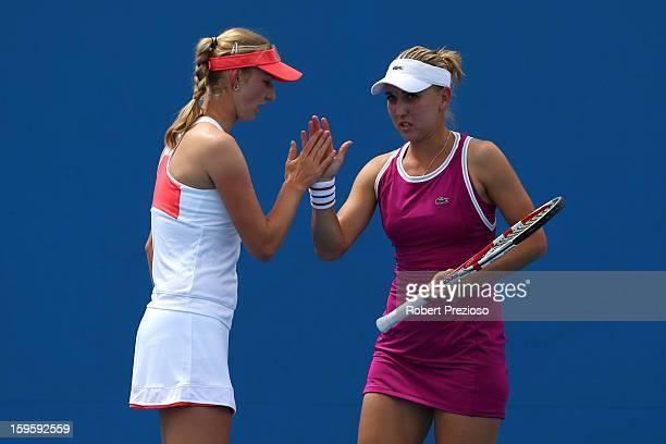 Ekaterina Makarova of Russia talks tactics with Elena Vesnina of Russia in their first round doubles match against Akgul Amanmuradova of Uzbekistan...