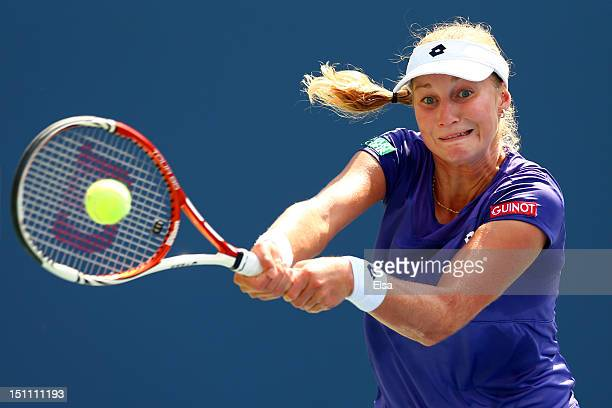 Ekaterina Makarova of Russian returns a shot against Serena Williams of the United States during their women's singles third round match on Day Six...