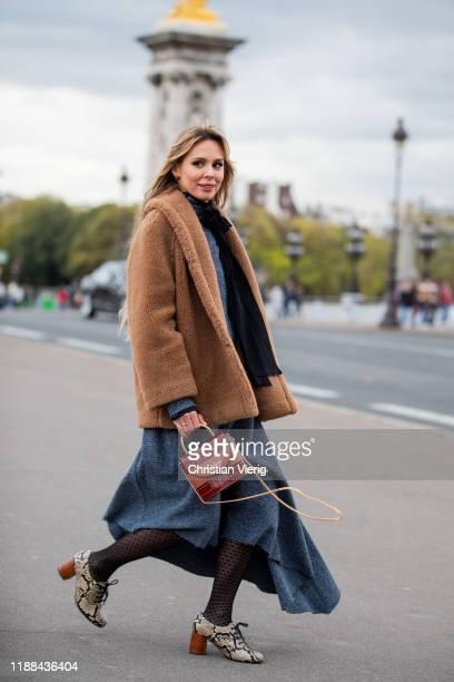 Ekaterina Mamaeva is seen wearing booties with snake print Chie Mihara, grey dress Litkovskaya, brown teddy jacket Max Mara, Chloe bag, Jacquemus...