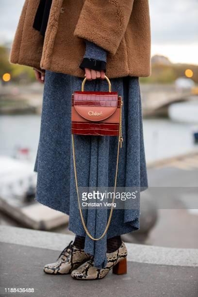 Ekaterina Mamaeva is seen wearing booties with snake print Chie Mihara, grey dress Litkovskaya, brown teddy jacket Max Mara, Chloe bag on November...