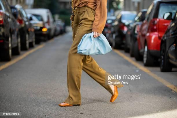 Ekaterina Mamaeva is seen wearing brown jumper Lou Lou Studio, khaki pants Petar Petrov, Miista shoes, blue Bottega Veneta bag, Yves Saint Laurent...