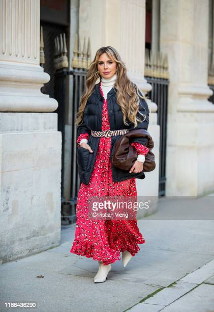 Ekaterina Mamaeva is seen wearing creme white boots The Row red dress with floral print Munthe belt with zebra animal print Loeffler Randall brown...