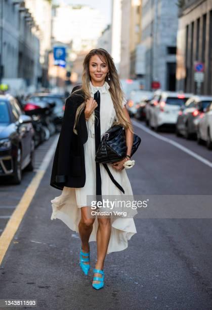 Ekaterina Mamaeva is seen wearing Dress Philosophy di Lorenzo Serafini, jacket Chanel, shoes Bottega Veneta, necklace Saint Laurent, earrings Chloe,...
