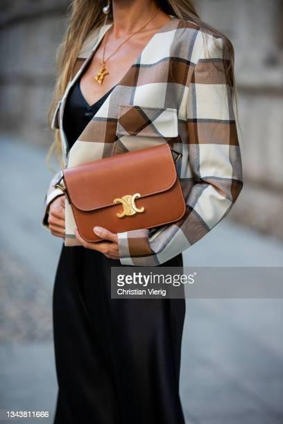 Ekaterina Mamaeva is seen wearing Dress Raey, Jacket Tibi, boots Manu Atelier, handbag Celine, earrings Chloe, necklace Oscar de la Renta during the...