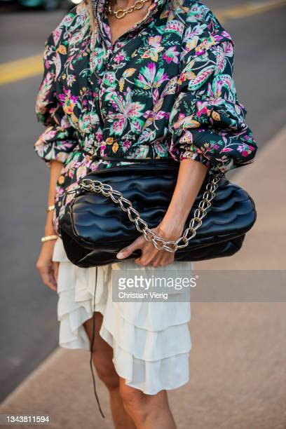 Ekaterina Mamaeva is seen wearing Jacket Isabel Marant Etoile, skirt Isabel Marant, boots Khaite, handbag Chloe, earrings Bottega Veneta, necklace...