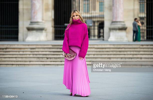 Ekaterina Mamaeva is seen wearing pink turtleneck knit sweater Acne Studios, boots with snake print Rosetta Getty, pink pleated skirt AWAKE Mode,...