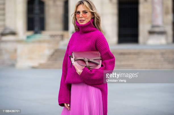 Ekaterina Mamaeva is seen wearing pink turtleneck knit sweater Acne Studios pink pleated skirt AWAKE Mode handbag Loewe sunglasses Alessandra Rich on...