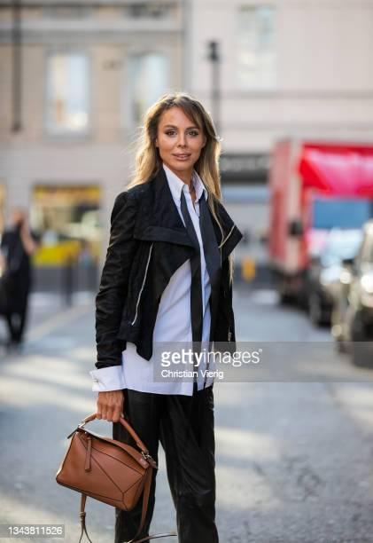 Ekaterina Mamaeva is seen wearing Shirt Alexandre Vauthier, jacket Rick Owens, leather pants Joseph, shoes Gianvito Rossi, necklace All Blues,...