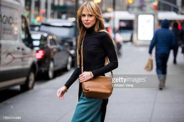 Ekaterina Mamaeva seen wearing brown bag Khaite braclet Ben Amun blue pants Acne turtleneck knit worn as a dress The Range during New York Fashion...