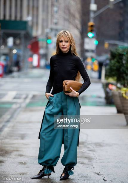 Ekaterina Mamaeva seen wearing brown bag Khaite braclet Ben Amun blue pants Acne shoes Petar Petrov turtleneck knit worn as a dress The Range during...