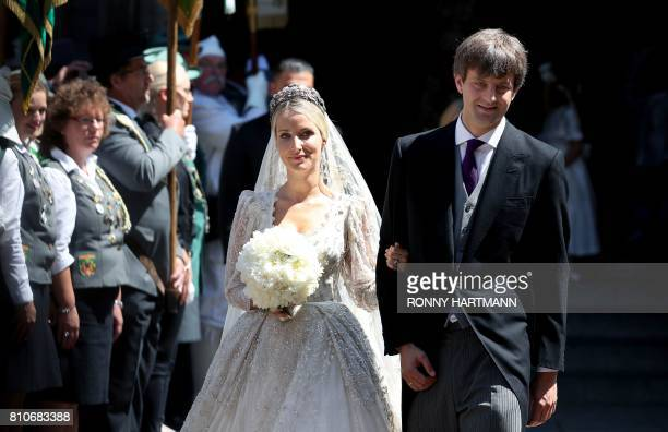 TOPSHOT Ekaterina of Hanover and Prince Ernst August of Hanover leave after their church wedding ceremony in Hanover central Germany on July 8 2017...