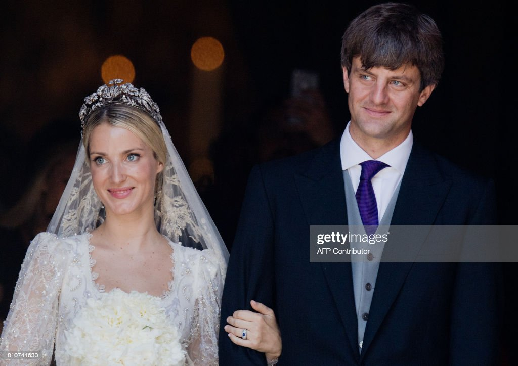 Ekaterina of Hanover and Prince Ernst August of Hanover leave after their church wedding ceremony in Hanover, central Germany, on July 8, 2017. Prince Ernst August of Hanover did not give in to the injunctions of his father and married his fiancee Ekaterina Malysheva, a fashion designer of Russian origin. / AFP PHOTO / dpa / Julian Stratenschulte / Germany OUT