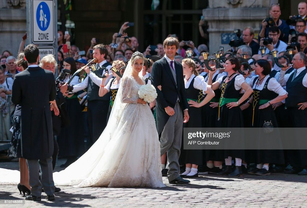 Ekaterina of Hanover and Prince Ernst August of Hanover leave after their church wedding ceremony in Hanover, central Germany, on July 8, 2017. Prince Ernst August of Hanover did not give in to the injunctions of his father and married his fiancee Ekaterina Malysheva, a fashion designer of Russian origin. / AFP PHOTO / dpa / Friso Gentsch / Germany OUT