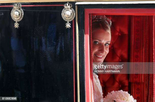 TOPSHOT Ekaterina of Hanover sits in a carriage after her church wedding ceremony in Hanover central Germany on July 8 2017 Prince Ernst August of...