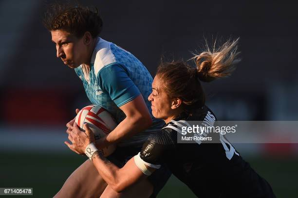 Ekaterina Skoromko of Russia is tackled by Niall Williams of New Zealand during the HSBC World Rugby Women's Sevens Series 2016/17 Kitakyushu pool...