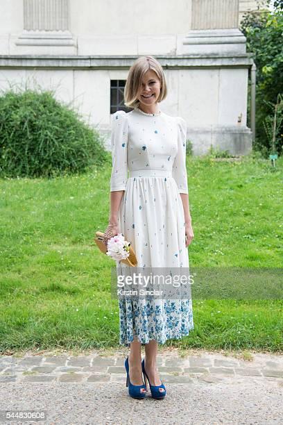 Ekaterina Smirnova wears a Ulyana Sergeenko dress and bag on day 1 of Paris Haute Couture Fashion Week Autumn/Winter 2016 on July 3 2016 in Paris...