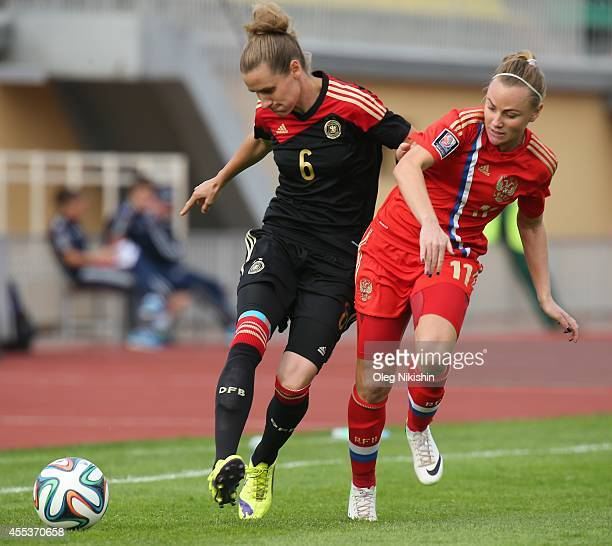 Ekaterina Sochneva of Russia challenged by Simone Laudehr Germany during Women's World Cup Qualifier between Russia v Germany at Luzhniki Stadium on...