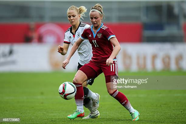 Ekaterina Sochneva of Russia is challenged by Leonie Maier of Germany during the UEFA Women's Euro 2017 Qualifier match between Germany and Russia at...