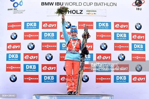 Ekaterina Yurlova of Russia celebrates on the podium during the IBU Biathlon World Cup Women's Pursuit on January 23 2016 in AntholzAnterselva Italy