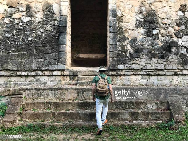 ek'balam, yucatan, mexico: tourist at mayan ruin - yucatan stock pictures, royalty-free photos & images