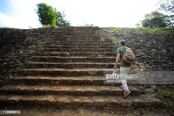 ek'balam yucatan, mexico: tourist at mayan ruin - steps stock pictures, royalty-free photos & images