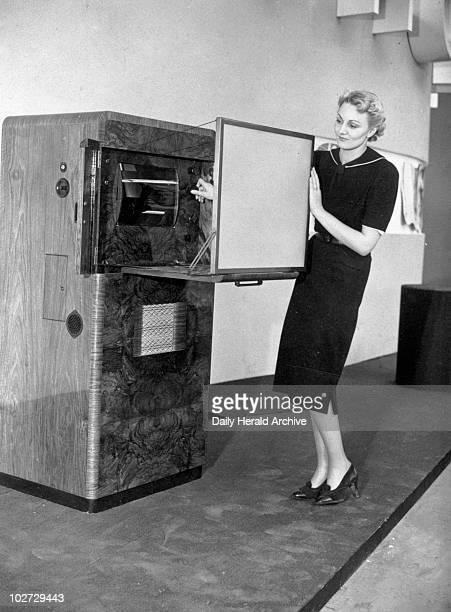 Ekco Scophony television set 23 August 1938 Ekco Scophony television set 23 August 1938 'Trying the controls of the Ekco Scophony 24 inch screen...
