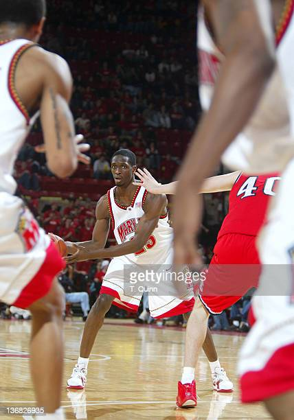 Ekene Ibekwe looks through a maze of players at Comcast Center in College Park Maryland on January 23, 2005.