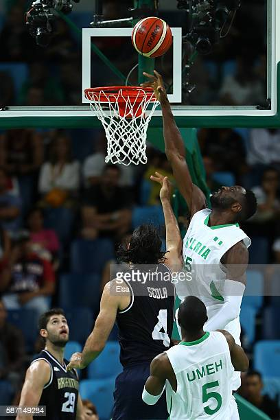 Ekene Ibekwe of Nigeria puts up a shot over Luis Scola of Argentina during a Men's preliminary round basketball game between Nigeria and Argentina on...