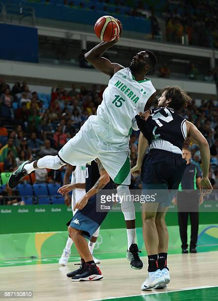 Ekene Ibekwe of Nigeria shoots the ball over Marcos Delia of Argentina during a Men's preliminary round basketball game between Nigeria and Argentina...